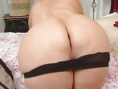 Big blonde woman in sexy underwear with huge tits does titjob