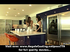 Lesbian brunette babes cooking and flashing tits