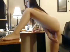 Lovely college bitch pokes her shaved dimple with a toy