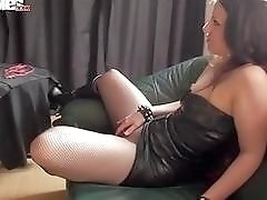 Busty brunette Dominatrix face-sits and fucks her hung male slave