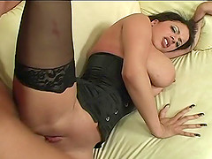 Dolled up brunette with long nails wants to bounce on a cock