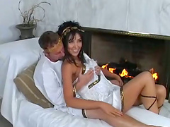 Sexy brunette in Ancient Greece clothes rides big dick