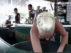 Busty waitress has to dig for cold drinks