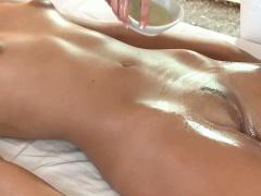 Brunette lesbian babe getting an oily massage