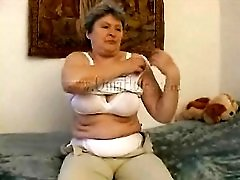 Big breasts granny strips and rubs her pussy