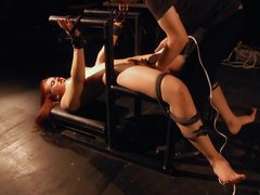 Innocent redhead constrained and used as sex toy