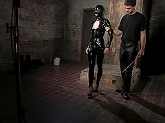 Sexy Blonde's Fucked In A Latex Suit By Her Master