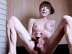 Erotic transsexual amateur massaging her hard dong on a dining table