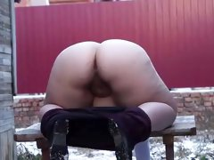 Fat Russian blonde takes off her pants and bends over to pee