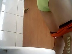 Cute white lady in maroon dress and green panties in the toilet room