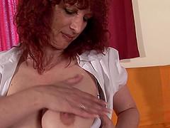 Petronila with big ass masturbating using toy in mature porn