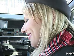 Romantic nympho Luci Angel takes a ride and gives a blowjob in the car