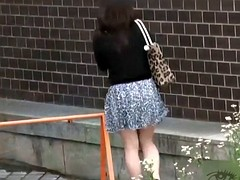 Asian chick in high heels takes a piss in public