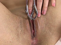 brunette babe poking big sex toy in a pink pussy