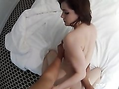 He holds her hips tight and fucks her cunt hard