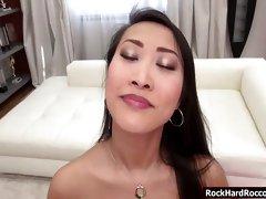 Asian Sharon Lee enjoys sucking two big cocks simultaneously