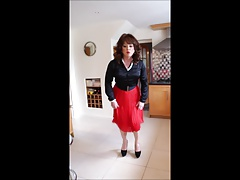 Sindy swishes her red pleated skirt