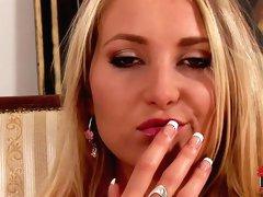 Pretty blonde Susan Snow rubs her clit