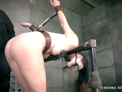 Restrained brunette gets her cunt fucked hard by crazy sex machine