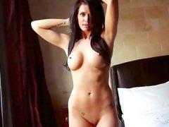 Brunette beauty poses nude