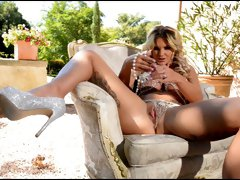 Amazing blond bitch with big jugs goes wild in the garden