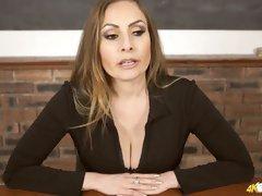 Red haired teacher Sophia Delane shows off her boobies