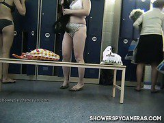 Spy camera in a public shower locker room catching naked women