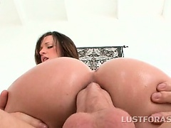 Oily redhead riding giant pecker in her tight butt hole